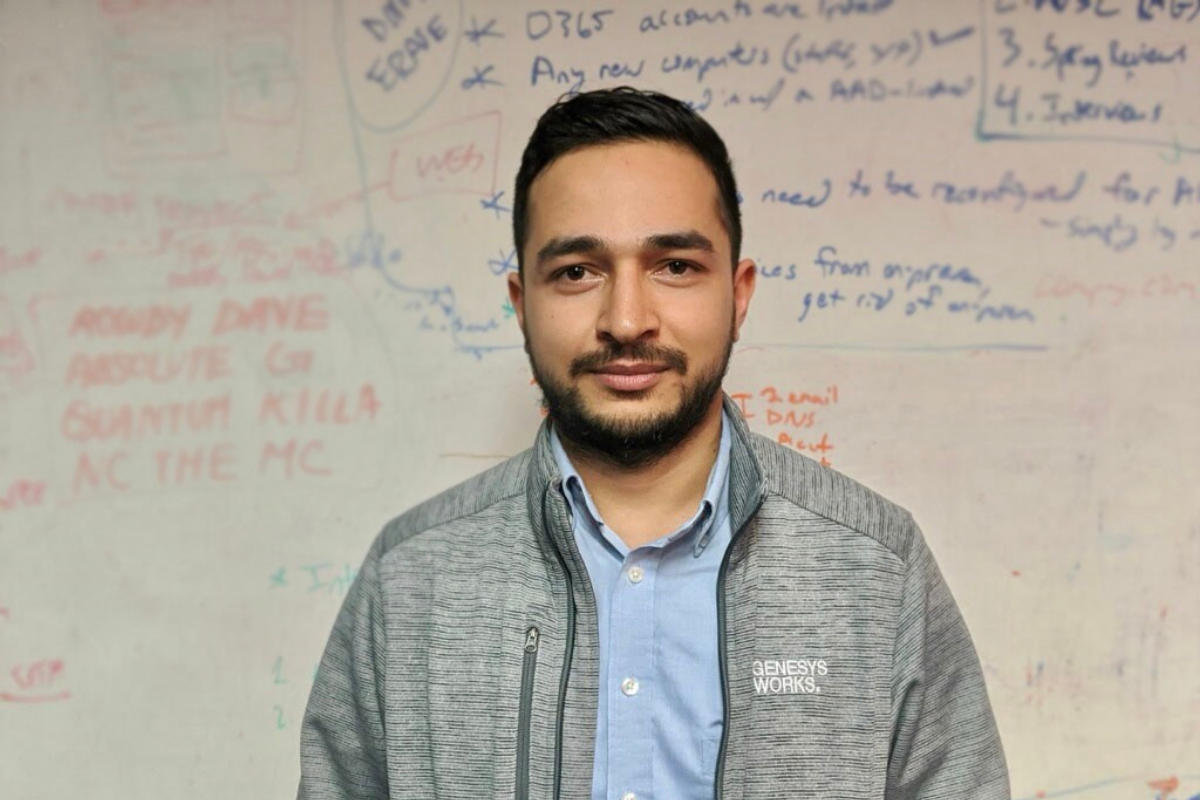 Genesys Works Alum Prashant Bashyal in front of our whiteboard